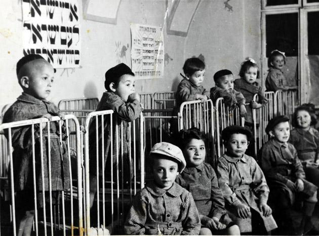 Jewish children in the children's home in Cluj after the war, among them the young twins Eliyahu and Yaakov Malek.