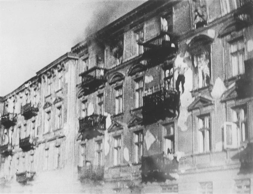 A Jew jumps to his death from the 4th floor window of a burning building during the suppression of the Warsaw Ghetto Uprising
