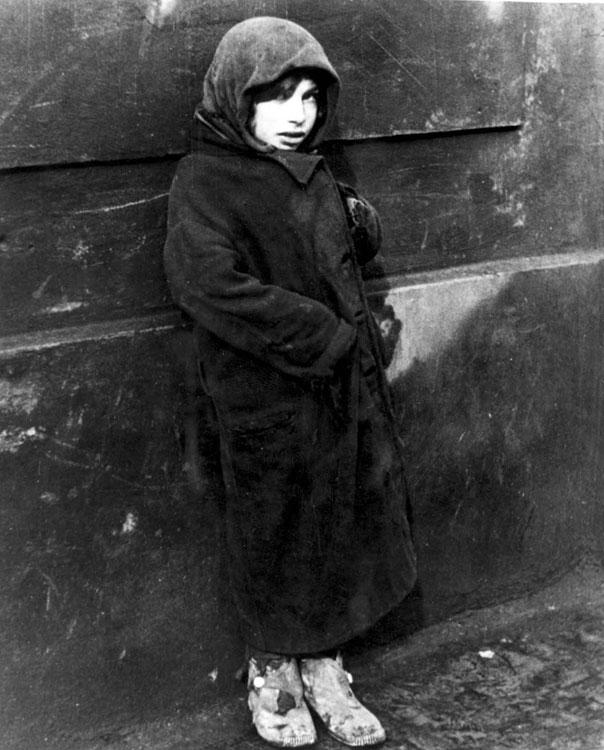Young girl on the streets of the Warsaw Ghetto, Poland, February 1941