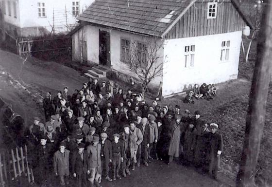 Jews waiting near the home of Judenrat Chairman Isidor Krumholtz before leaving to perform forced labor outside the ghetto, Andrychów Ghetto, 1942