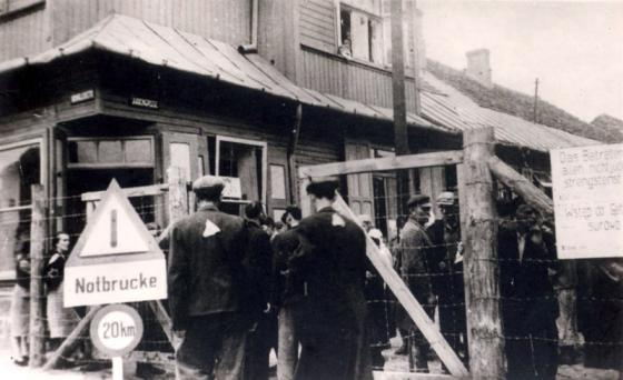 """Ghetto entrance gate. """"Entry by non-Jews absolutely forbidden"""" is inscribed on the sign, Gostynin Ghetto"""