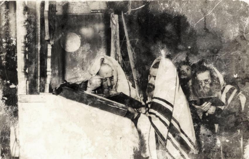 Jews at prayer during the Jewish holiday of Sukkot (The Feast of the Tabernacles), in the Lodz Ghetto, Poland, October 1941