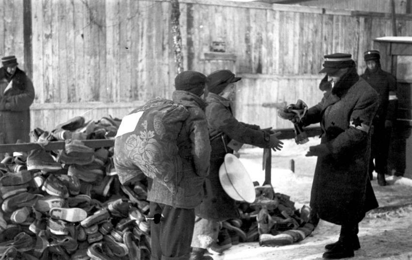 Distribution of wooden clogs to deportees during the deportations from the Lodz Ghetto