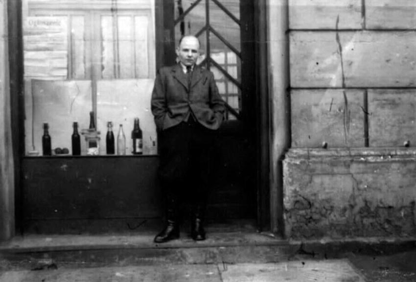 Leopold Socha standing in front of the tavern he opened at the end of the war in Gliwice, Poland, 1945
