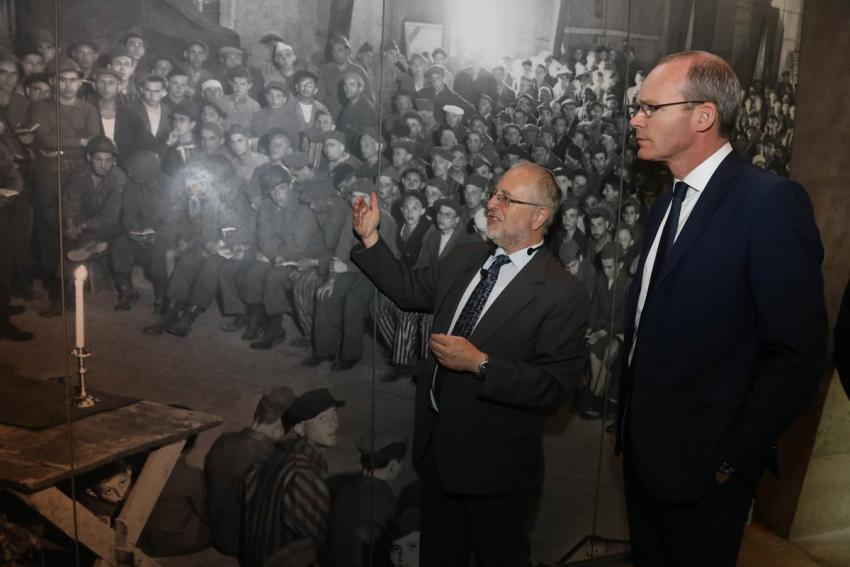 Irish Foreign Minister Simon Coveney (right) at the exhibit on liberation in the Holocaust History Museum