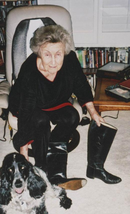 Mira Becker in her home when donating the boots to a representative of Yad Vashem