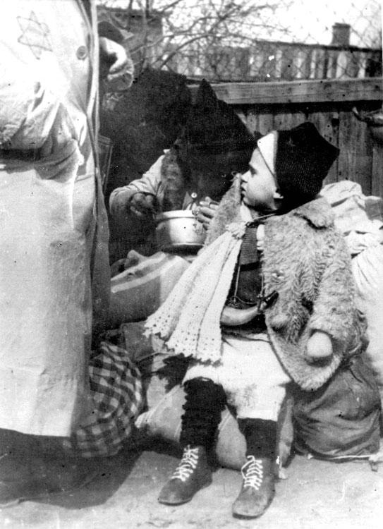 "A child deported during the ""Sperre"" in the Lodz Ghetto, Poland, September 1942"