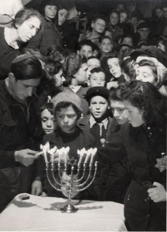 A Hanukkah candle lighting ceremony in the Westerbork transit camp, Netherlands, December 1943