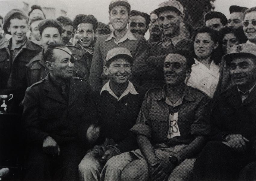 "Israel Uryn (second from left in second row, standing behind Moshe Dayan) while volunteering with ""Machal"" (IDF Volunteers from Overseas)"