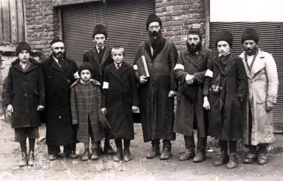 Rabbi Josef Weber (center) with his sons and other Brzozow Jews, in a photograph taken by the Germans. According to testimonies, shortly before the liquidation of the ghetto, the people pictured were led to the Lazenki forests and murdered, Brzozow Ghetto
