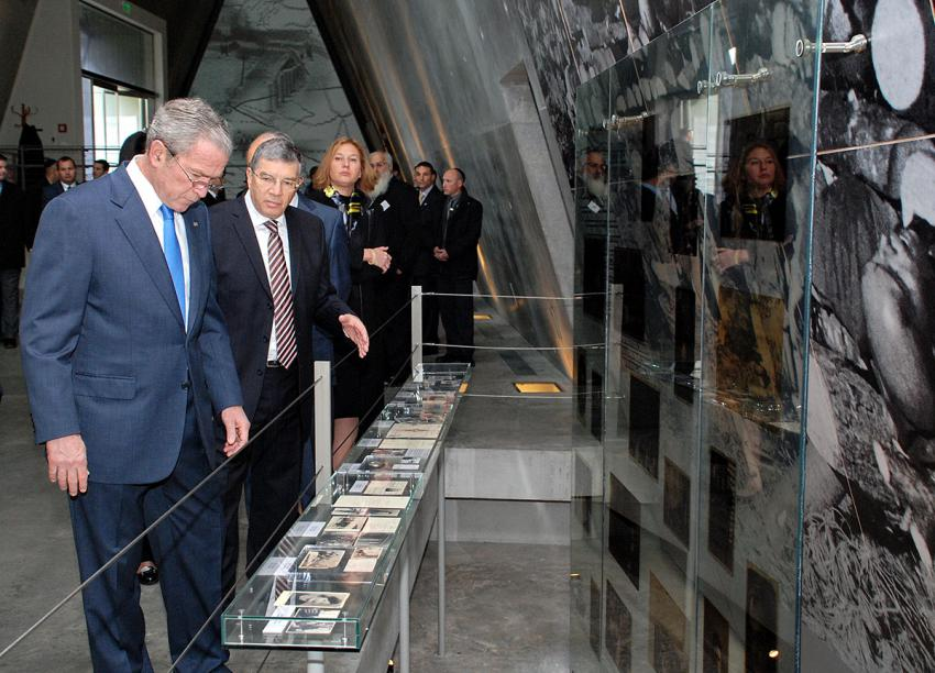 President Bush, guided by Chairman of the Yad Vashem Directorate Avner Shalev, studies an exhibit in the Holocaust History Museum