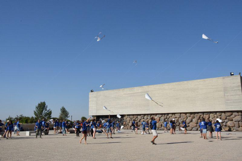 Member of the Mahanot Haolim youth movement fly kites in the Square of Hope at Yad Vashem in memory of Janusz Korczak, Stefa Wilczynska and the children murdered at Treblinka