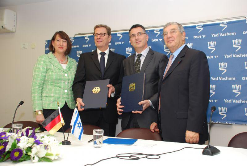Pictured here are: Chairperson of the Society of Friends of Yad Vashem in Germany Hildegard Muller, German Foreign Minister Guido Westerwelle, Israeli Education Minister Gideon Sa'ar, and Avner Shalev, following the signing of the agreement