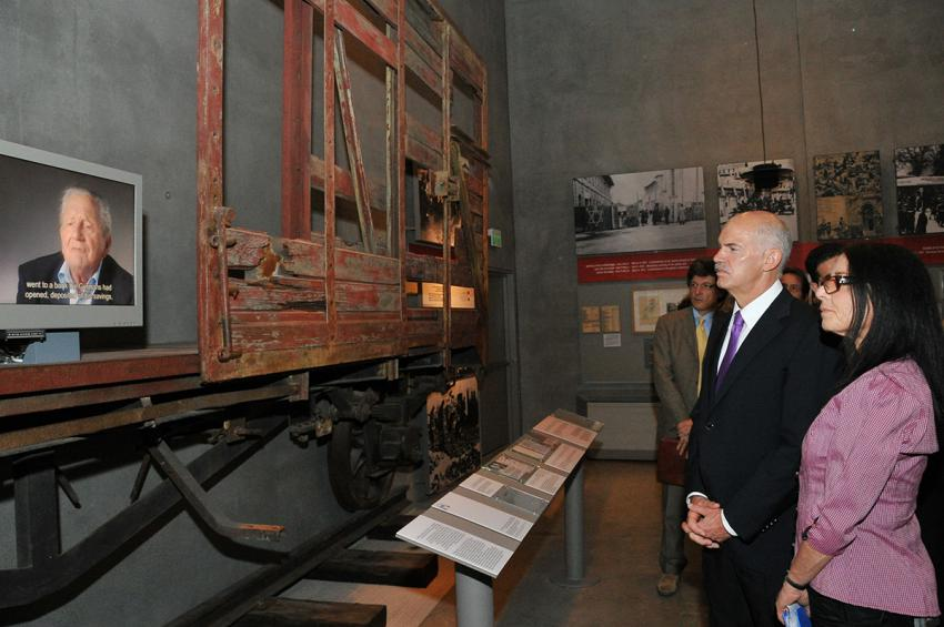 The Prime Minister and Ms. Shendar listen to a testimony from a Greek Jewish Holocaust survivor in the Holocaust History Museum
