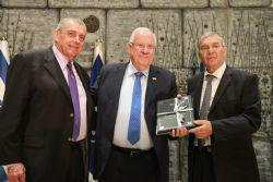 Yad Vashem Chairman Avner Shalev  together with Chairman of the American Society for Yad Vashem Leonard Wilf presenting Israeli President Reuven Rivlin with a facsimle of the Wolfsberg Machzor