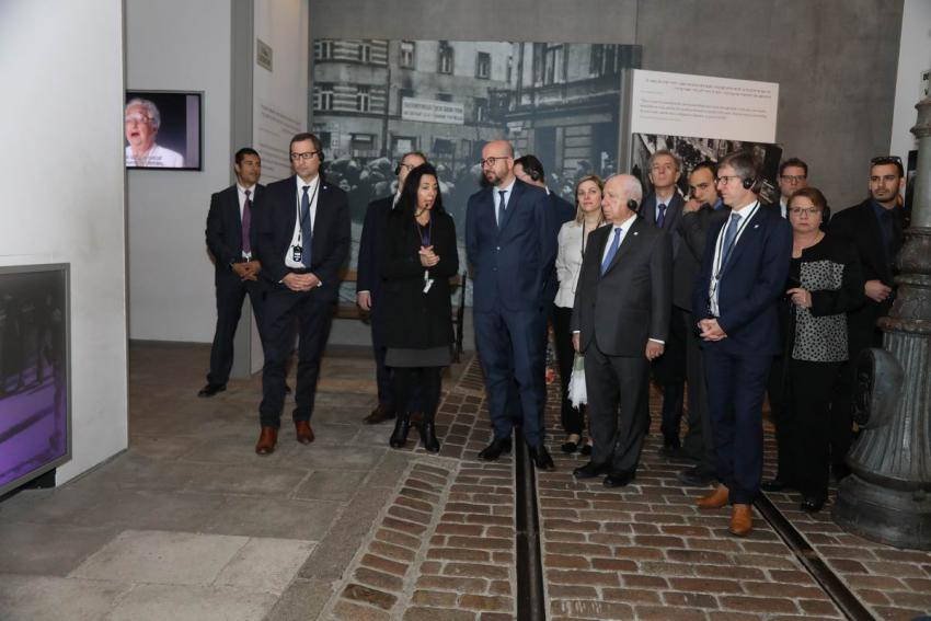 "Prime Minister Michel toured the Holocaust History Museum, including the reconstructed ""Leszno Street"" of the Warsaw ghetto"