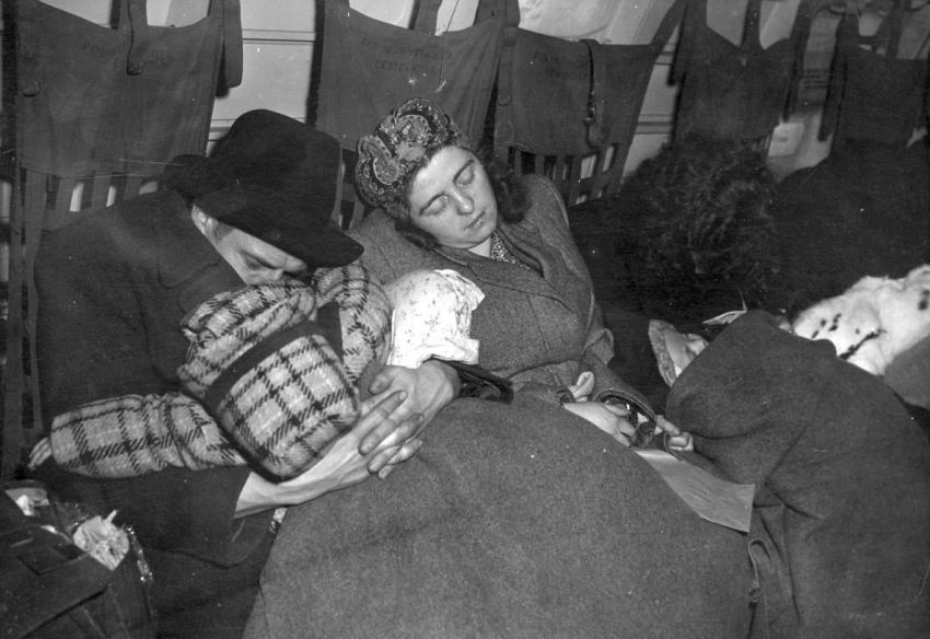 Refugees Sleeping Aboard an American Airplane, on a Flight Leaving Germany