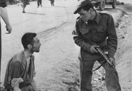 After Liberation, A British Soldier Speaking with a Prisoner in the Camp, Bergen Belsen, Germany