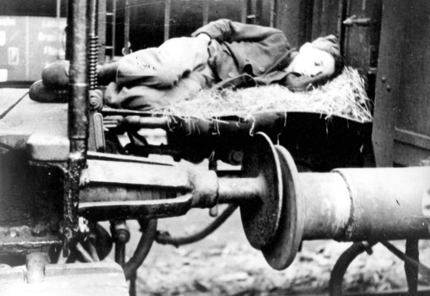 A Child Sleeping Between Train Cars on the Return Journey from Buchenwald to Hungary