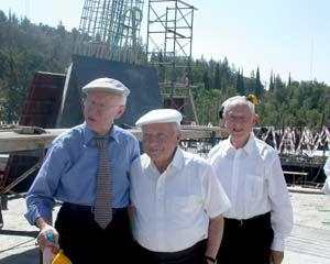 Eli Zborowski describes the progress of the Visitors' Center to brothers Arie and Sam Halpern