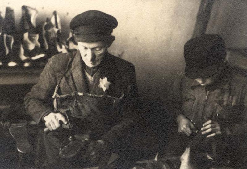 An elderly man and a teenager in shoemakers school in the ghetto, Kaunas, Lithuania, 1943