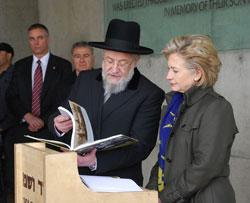 Rabbi Israel Meir Lau, Chairman of the Yad Vashem Council, presents Secretary Clinton with To Bear Witness, a book about Yad Vashem, at the conclusion of her visit today