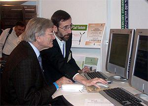 Eli Hurvitz (left), Israel Chairman of the GA, searches the database with Alex Avraham, Director of Yad Vashem's Hall of Names