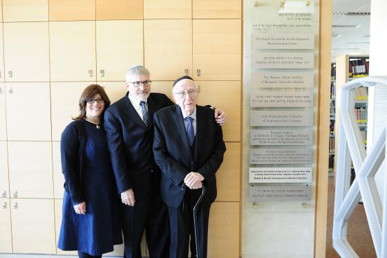 "Rabbi Dr. David Eliach, joined by his son Yotav Eliach and daughter Smadar Rosensweig to unveil the plaque marking the donation of the private collection, The Prof. Yaffa Eliach z'""l Shtetl Collection to the Yad Vashem Archives"