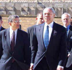 Sec. of State Powell, accompanied by the Chairman of the Yad Vashem Directorate Avner Shalev, (left) arrives at Yad Vashem. American Ambassador to Israel, Martin Indyk, far right
