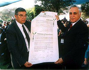 President of Israel, Moshe Katsav (right) displaying the Declaration of Remembrance with Avner Shalev, Chairman of the Yad Vashem Directorate 17.9.2003