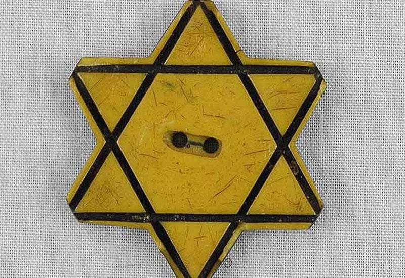 A Yellow Star of David Button