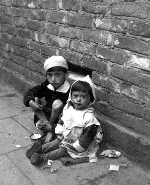 Children Sitting on the Pavement Soliciting Alms, Warsaw, Poland