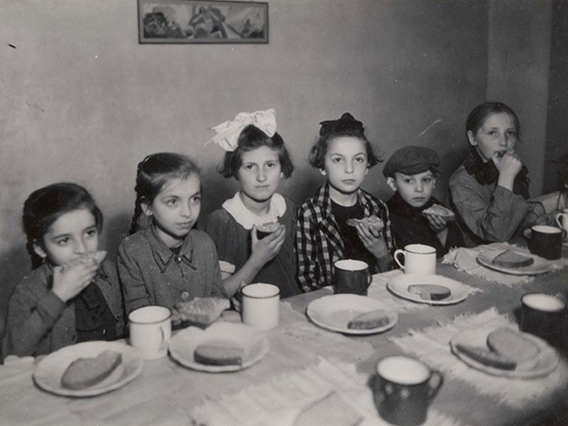 Warsaw, Poland, Girls eating in a Soup Kitchen in the Ghetto