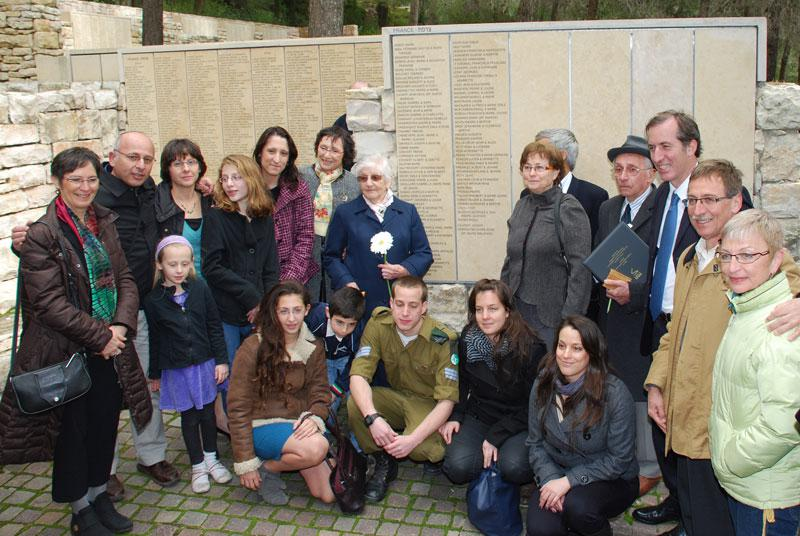 Gabi Hochman (who was saved by Righteous Among the Nations Sister Marie Emilienne and the late Father Joseph Caupert) together with family members and Sister Marie Emilienne in the Garden of the Righteous Among the Nations at Yad Vashem