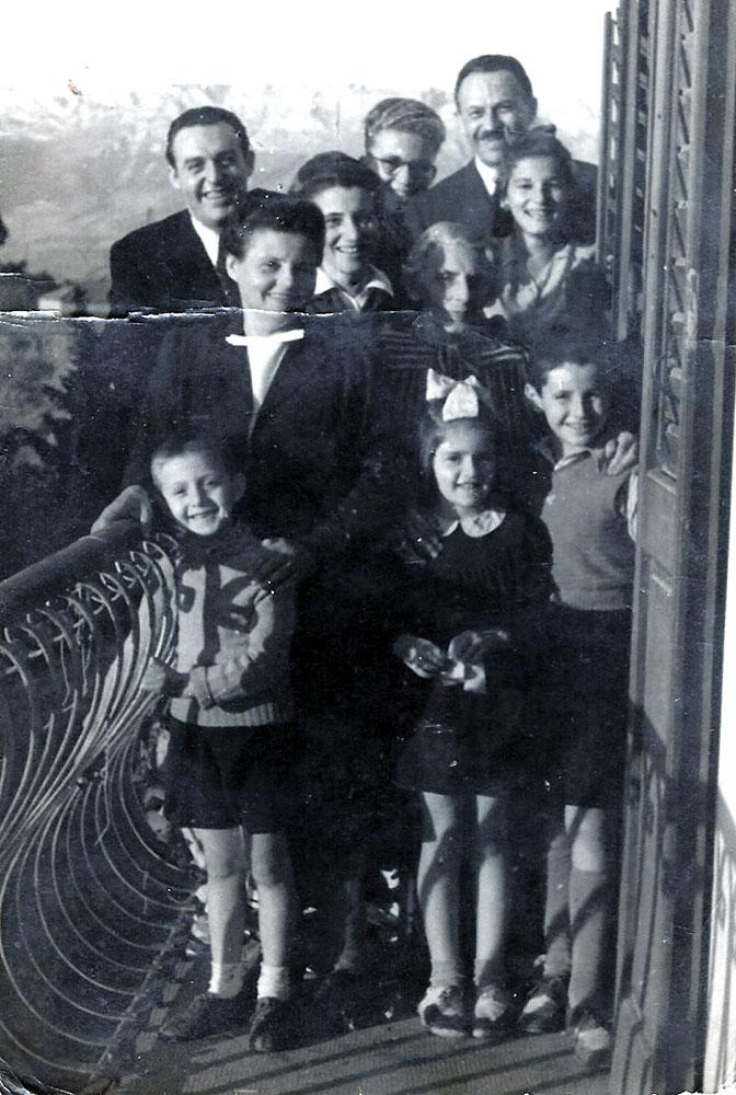 The children saved by Ignac Weiss, director of the Jewish retirement home in Zagreb Gavro Sternfeld (from right, bottom), his sister Leah and their cousin Leo Herman, Split, Croatia, 1943