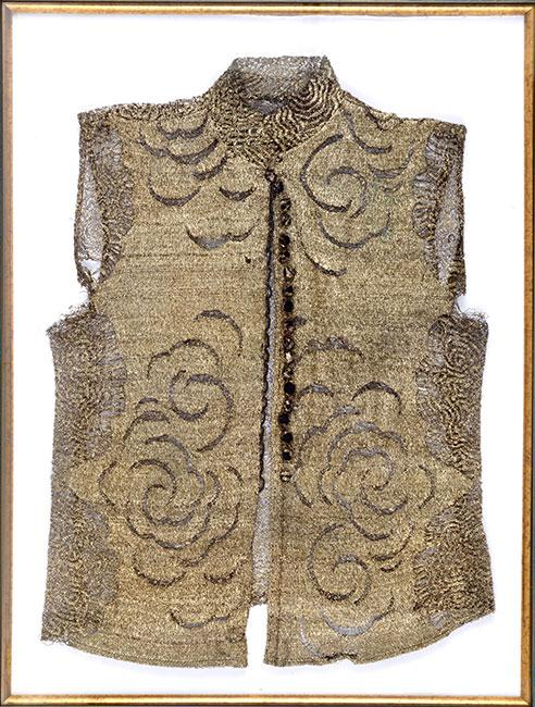 A waistcoat knitted from silver thread by Sol Levi over the course of four years. It is the only item that has remained in the possession of her son Marcel, who survived the Holocaust.