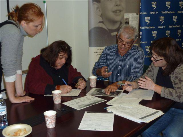 The Korenblums complete forms commemorating their family members that survived or were murdered during the Holocaust
