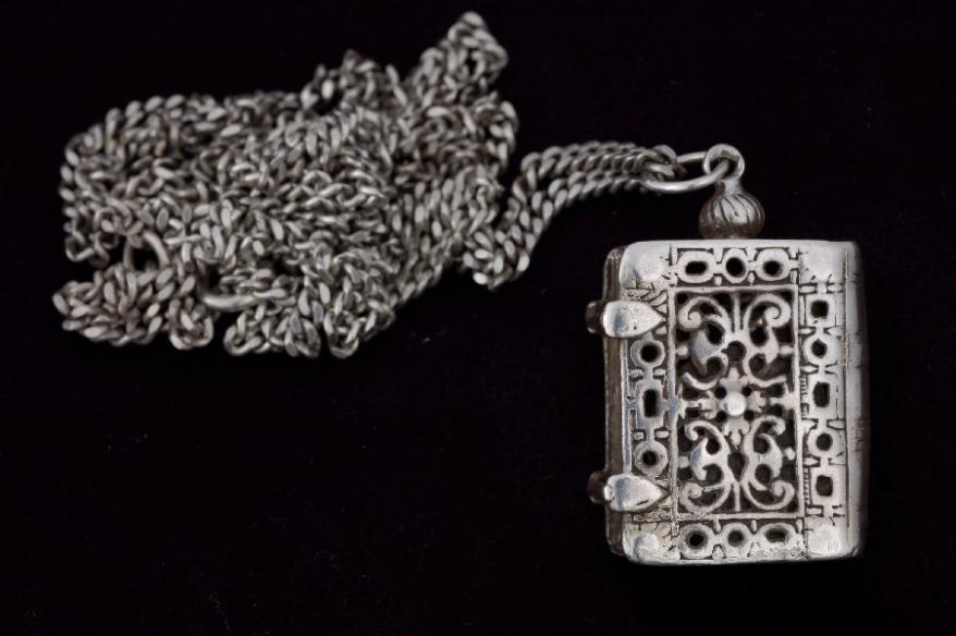 A silver pendant in the shape of a book from Heinz Samson's mother