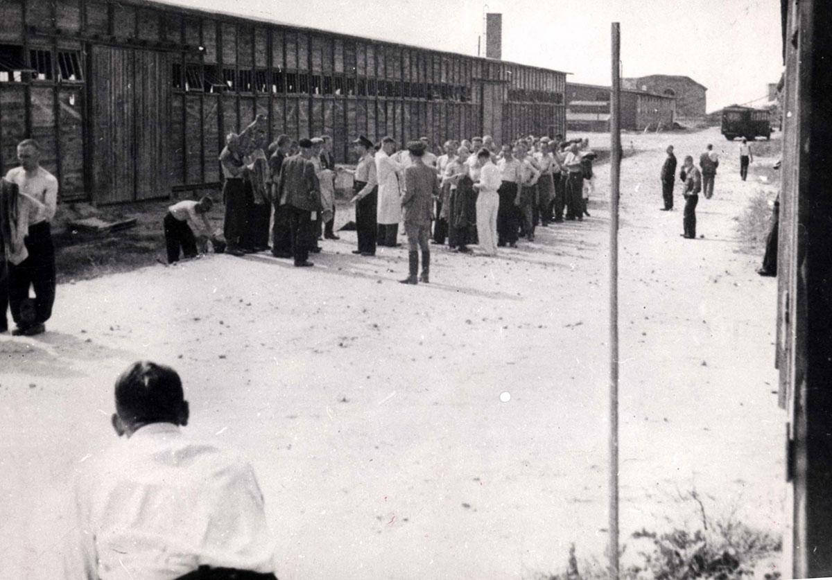 Treblinka, Poland, Prisoners Standing Next to a Barrack in the Camp, Being Inspected by a Doctor