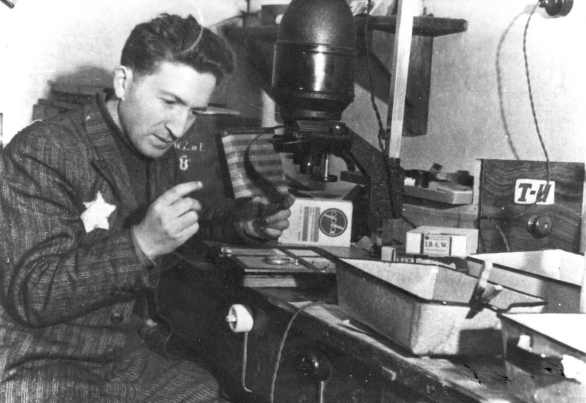 The photographer Mendel Grossman in his laboratory in the Lodz Ghetto, Poland