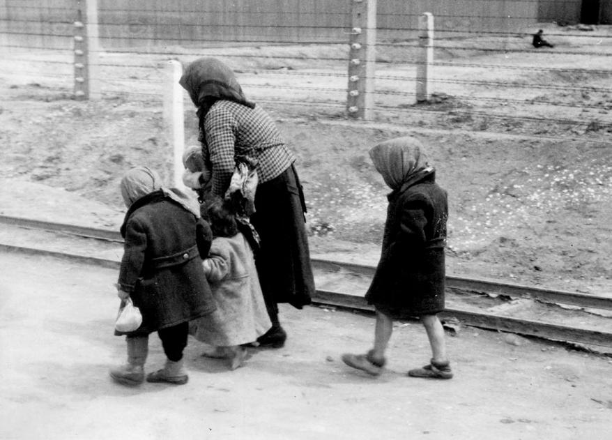 """Auschwitz-Birkenau, women and children deemed """"unfit for work"""" being led unknowingly to Gas Chamber #4"""