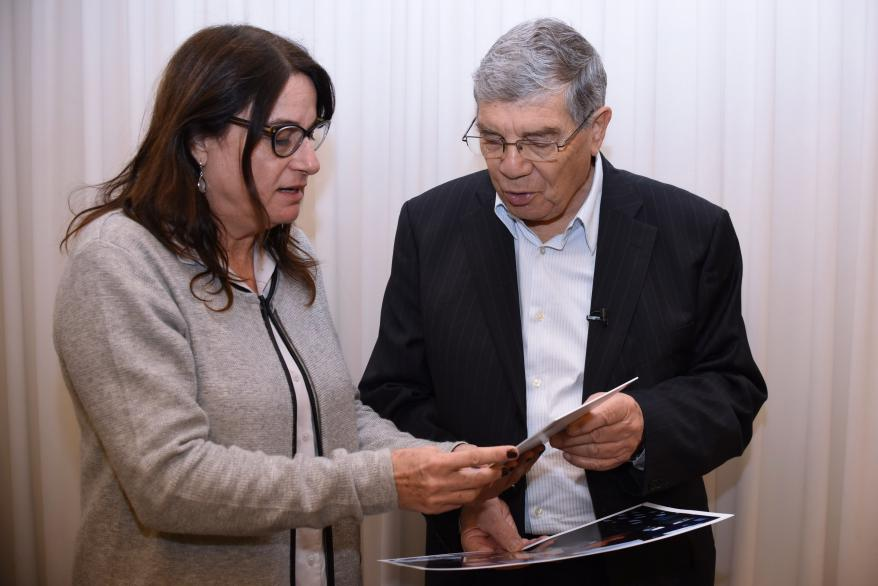 """Yad Vashem Chairman Avner Shalev presents Rona Ramon, widow of the Ilan Ramon, with a copy of Petr Ginz's """"Moon Landscape."""" The drawing will be sent to NASA Astronaut Drew Feustel to take on his upcoming mission to the International Space Station."""