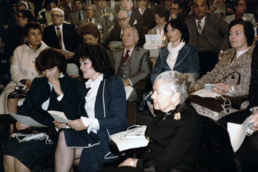 Clara (right, second row) and the wife of French President Mitteran (front, left) and Israeli President Navon (front, second left) at an event in Yad Vashem's campus