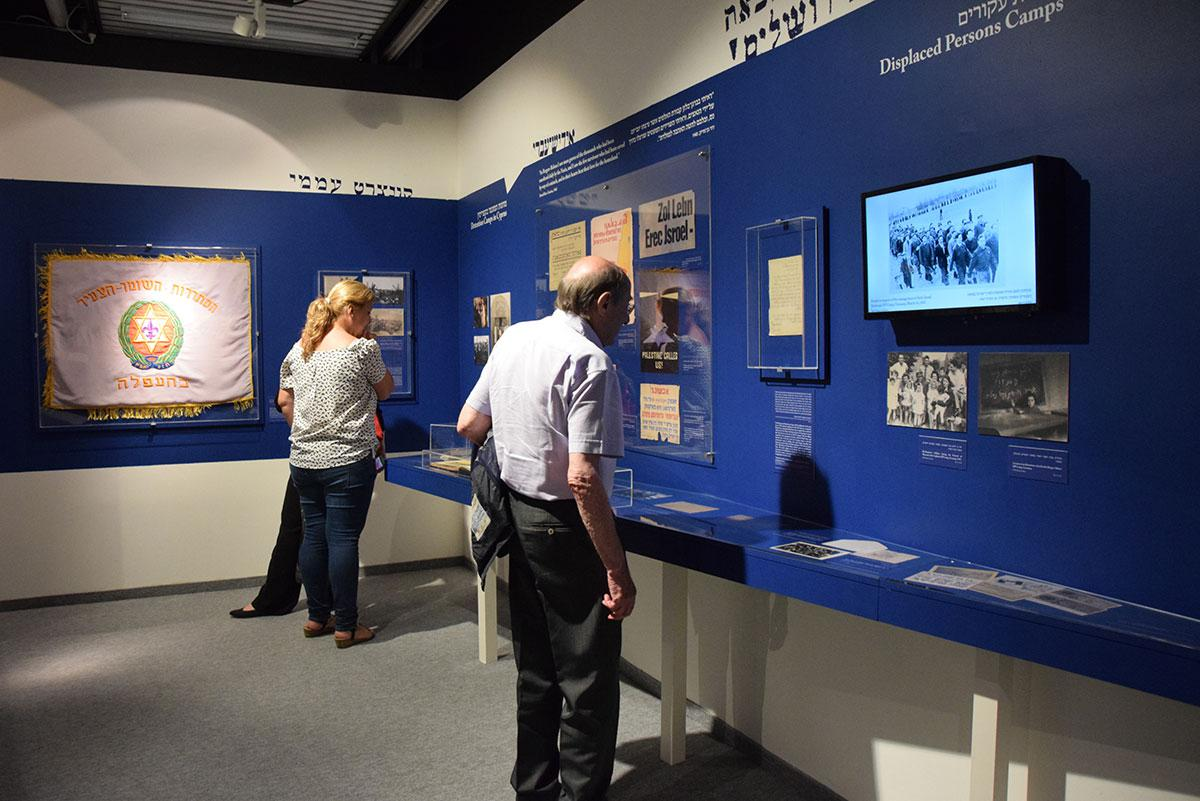 "Visitors at the exhibition ""They Say There Is a Land - Longings for Eretz Israel during the Holocaust"""