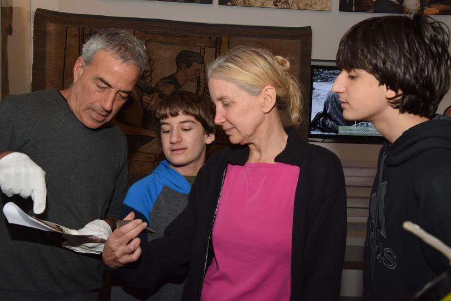 Michael Tal presents Tina Rosenstein and her children with a photo he discovered of her grandfather Jakob Stopnicki before the war