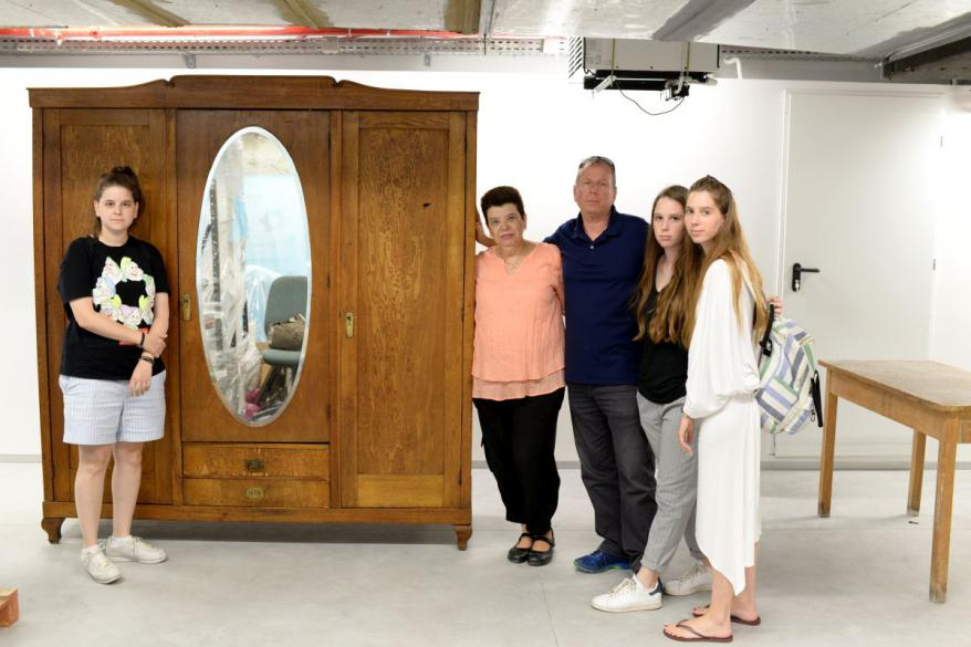 Tamar Doron and family at Yad Vashem to see the armoire that saved Tamar's mother's Genia Bartov (nee Sznajder) life during the Holocaust