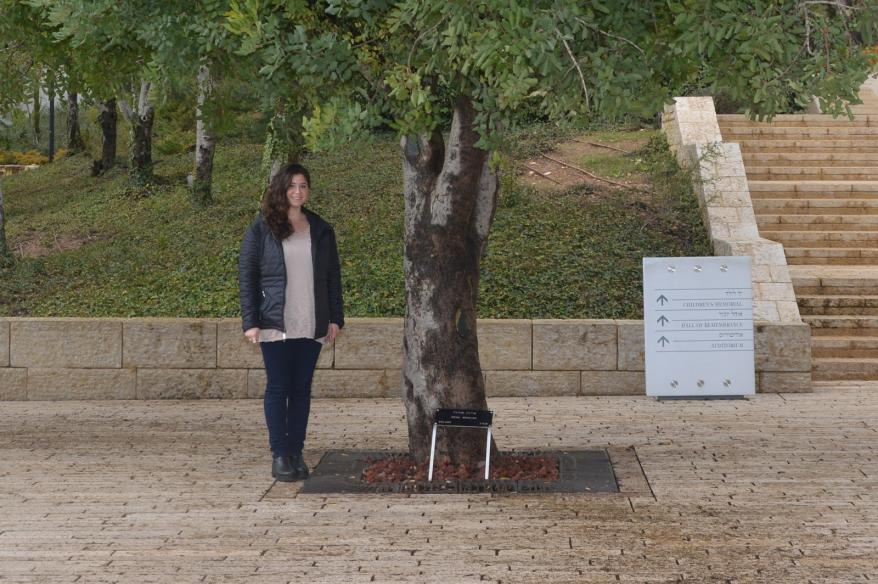 Alana standing next to Righteous Among the Nations, Irena Sendler tree