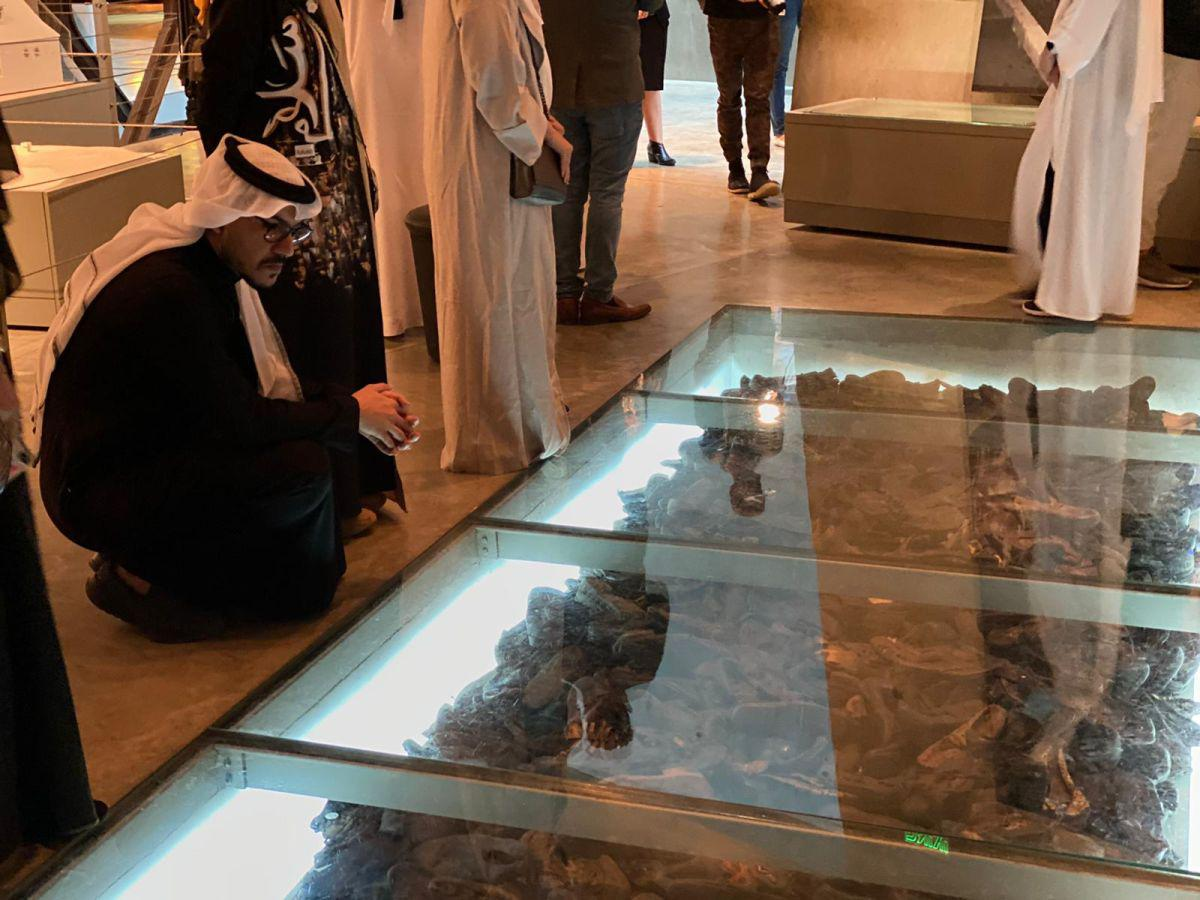 Member of the delegation reflecting on the exhibition of Holocaust victims' shoes displayed in Yad Vashem's Holocaust History Museum