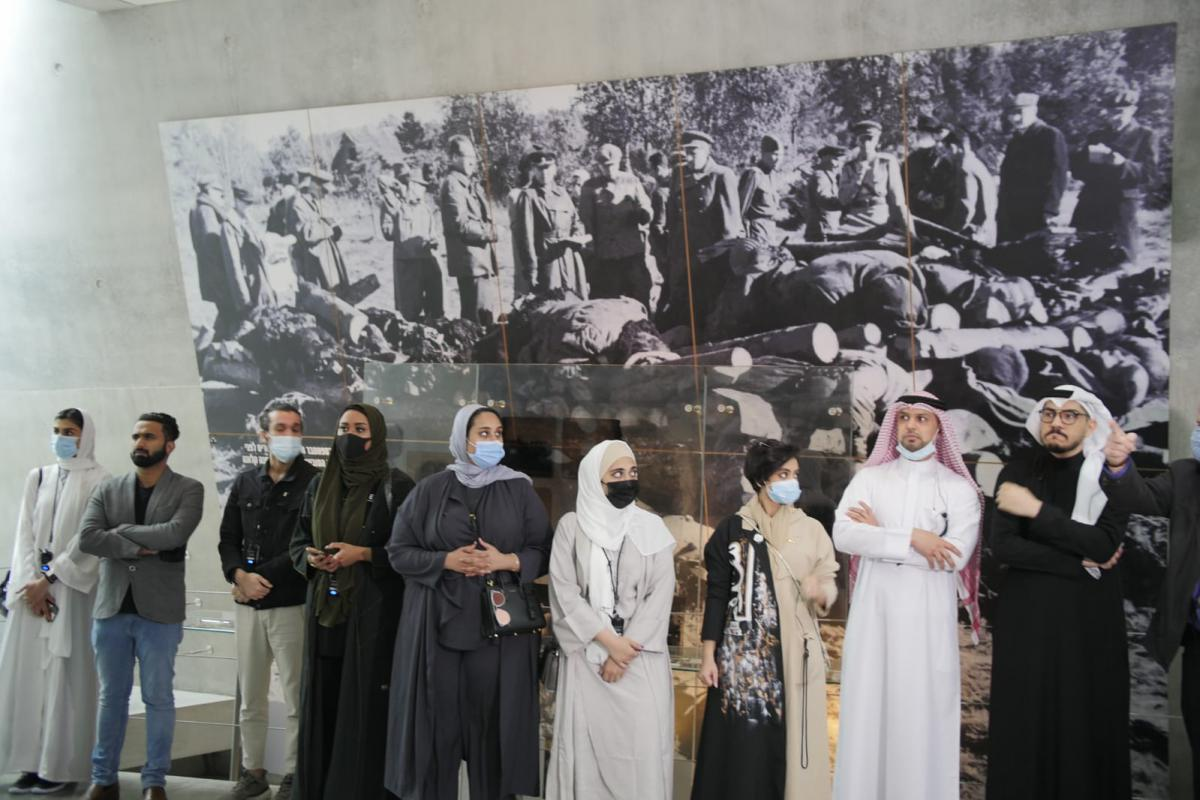 Members of the delegation from the UAE and Bahrain in front of the Klooga Forced Labor camp display in the Holocaust History Museum