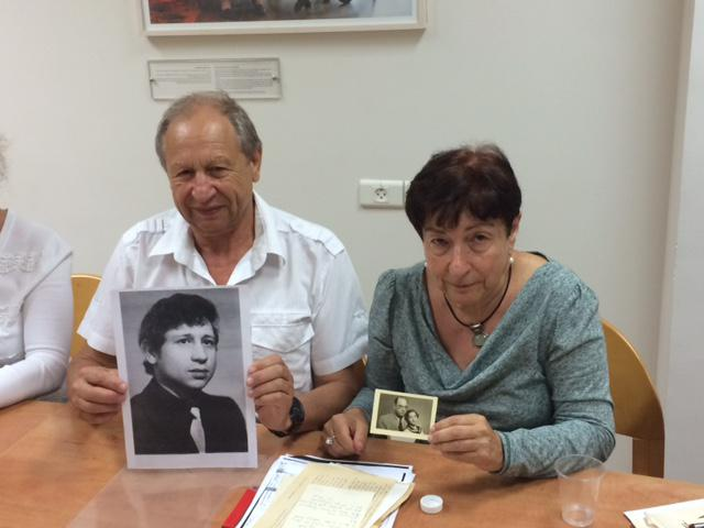 Valery and Dalia holding family pictures